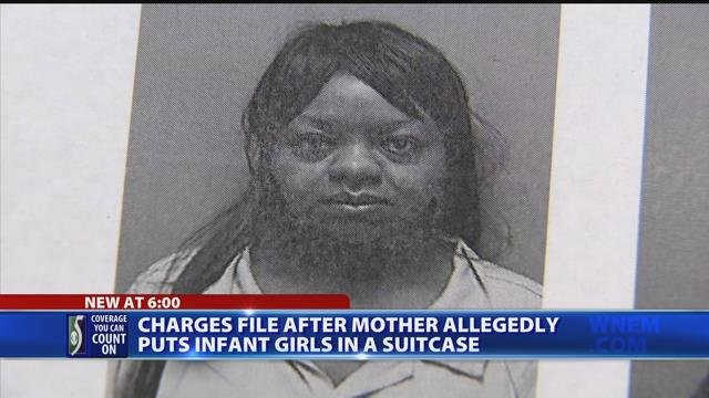 Charges filed after mother allegedly put infant girls in suitcase