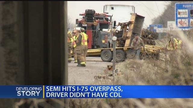 Semi hits I-75 overpass, driver didn't have CDL