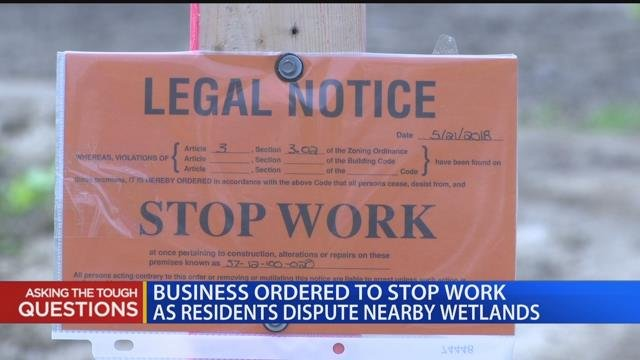 Business expansion halted because of wetland dispute