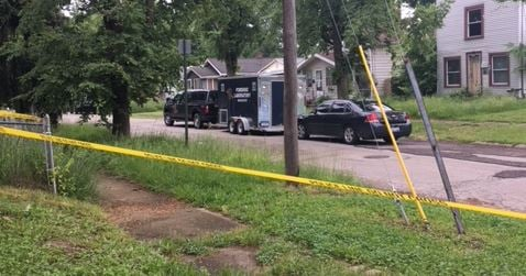 Police at the scene of a homicide in Flint. (Source: WNEM)