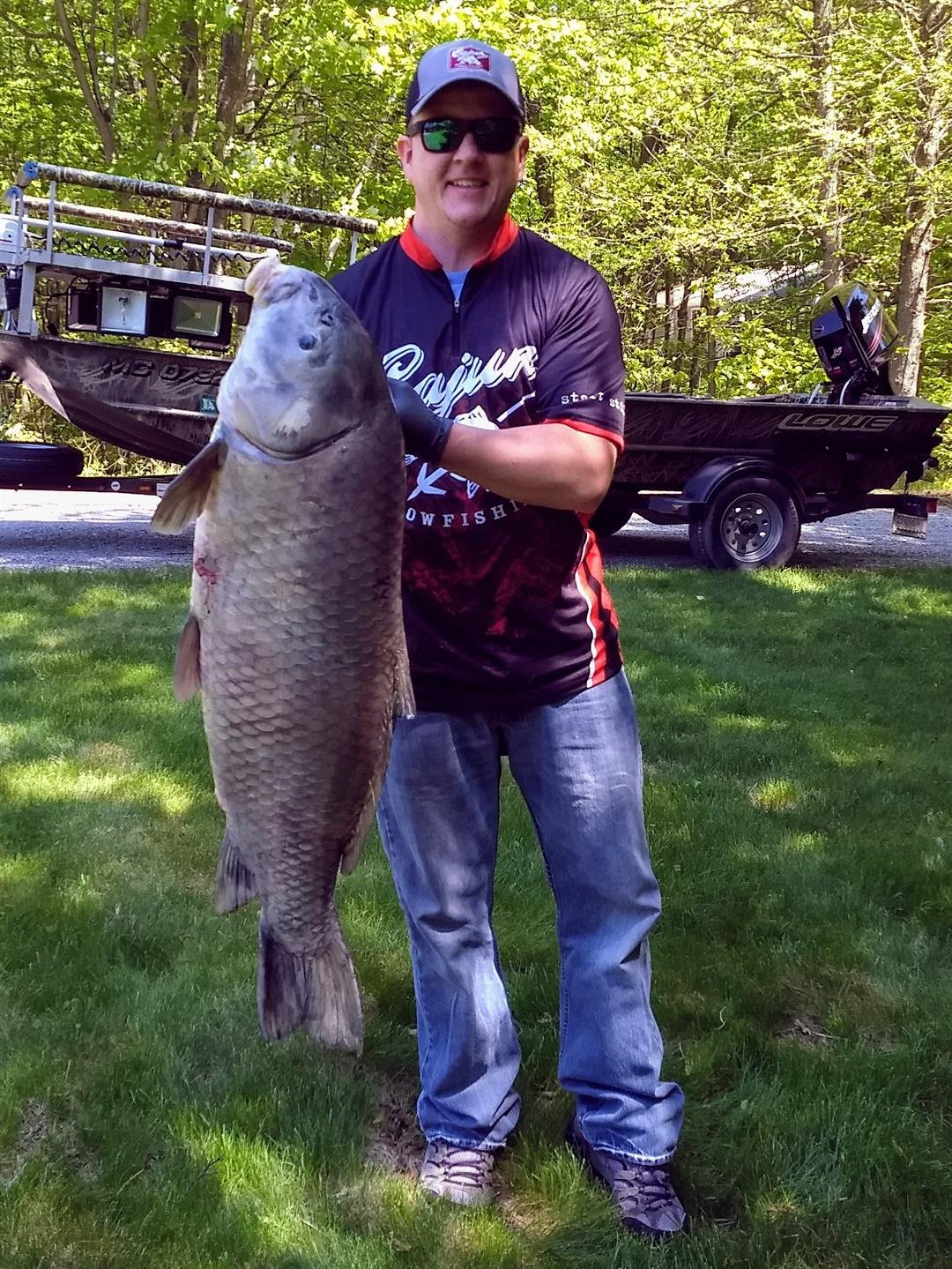 Brandonn Kramer poses with his state record black buffalo, taken while bowfishing on the Grand River in Ottawa County this past May (Source: DNR)