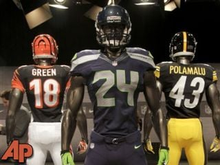 The new Seattle Seahawks uniform, foreground, Pittsburgh Steelers, rear right, and Cincinnati Bengals, rear left. (AP Photo/Seth Wenig)
