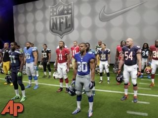 NFL players stand in their new uniforms. (AP Photo/Seth Wenig)