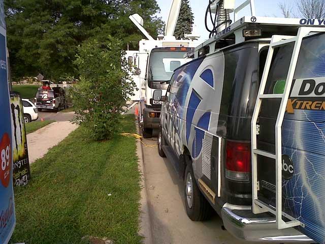 Media trucks line the streets
