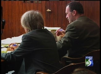 Ken Bluew sitting with his defense attorney, Rod O'Farrell.