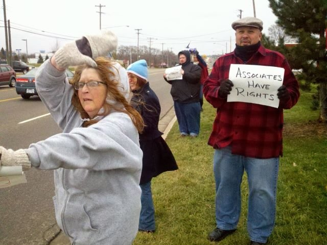 Protestors gathered outside a Wal-Mart in Flint Township on Friday.