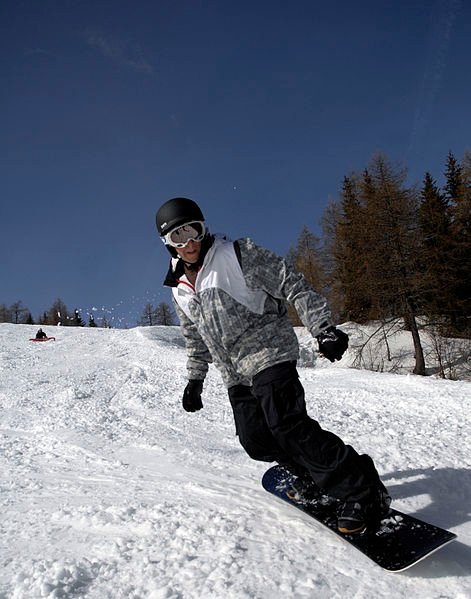 A person snowboarding down a ski hill.