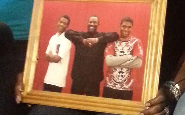 The shooting victim, Gianni Herron, is pictured in the red shirt on the right.