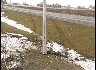 Skidmarks from the road into a powerline pole.