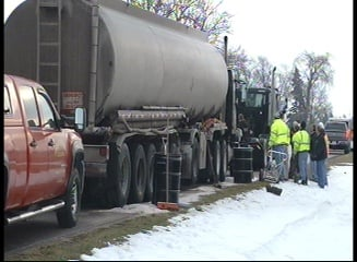 This gas transport truck was hit by a car that slid on an icy road.