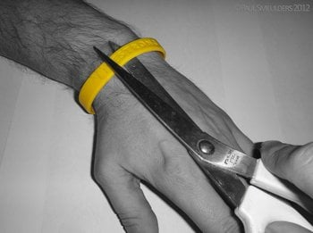 A Livestrong bracelet being cut off