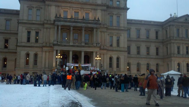 Union members protesting outside Gov. Rick Snyder's State of the State address Wednesday night.