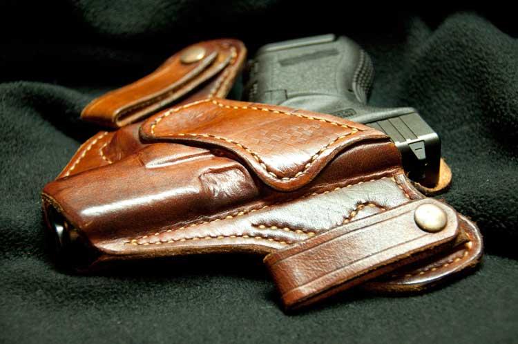 A handgun in a holster.