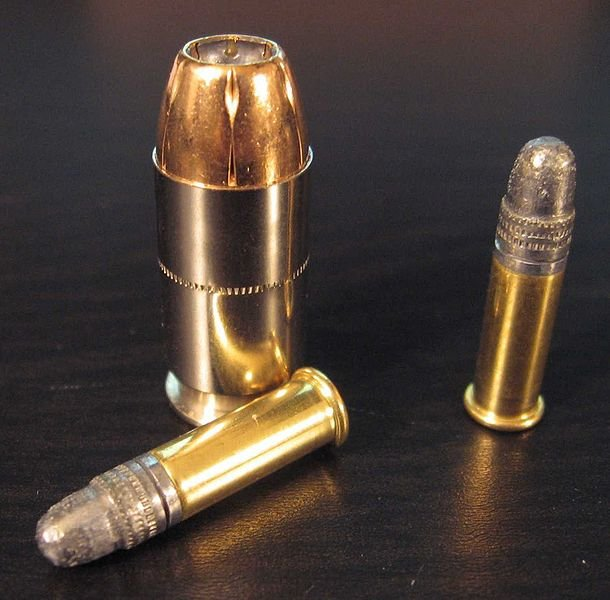 .22 caliber bullets next to a .45 caliber hollow-point.