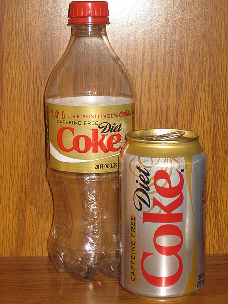 A 20 oz. plastic bottle of Coke and a 12 oz. can of Coke.