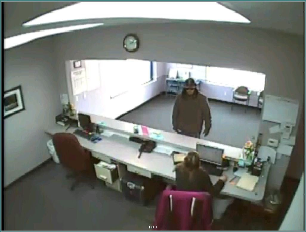 The armed robber seen through a security camera.