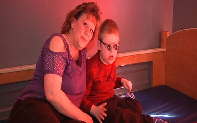 Riley and his mom, Terri. Riley uses special glasses to see correctly due to brain damage he suffered as a baby.