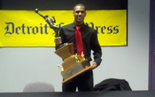 Monte Morris holding the Mr. Basketball trophy.