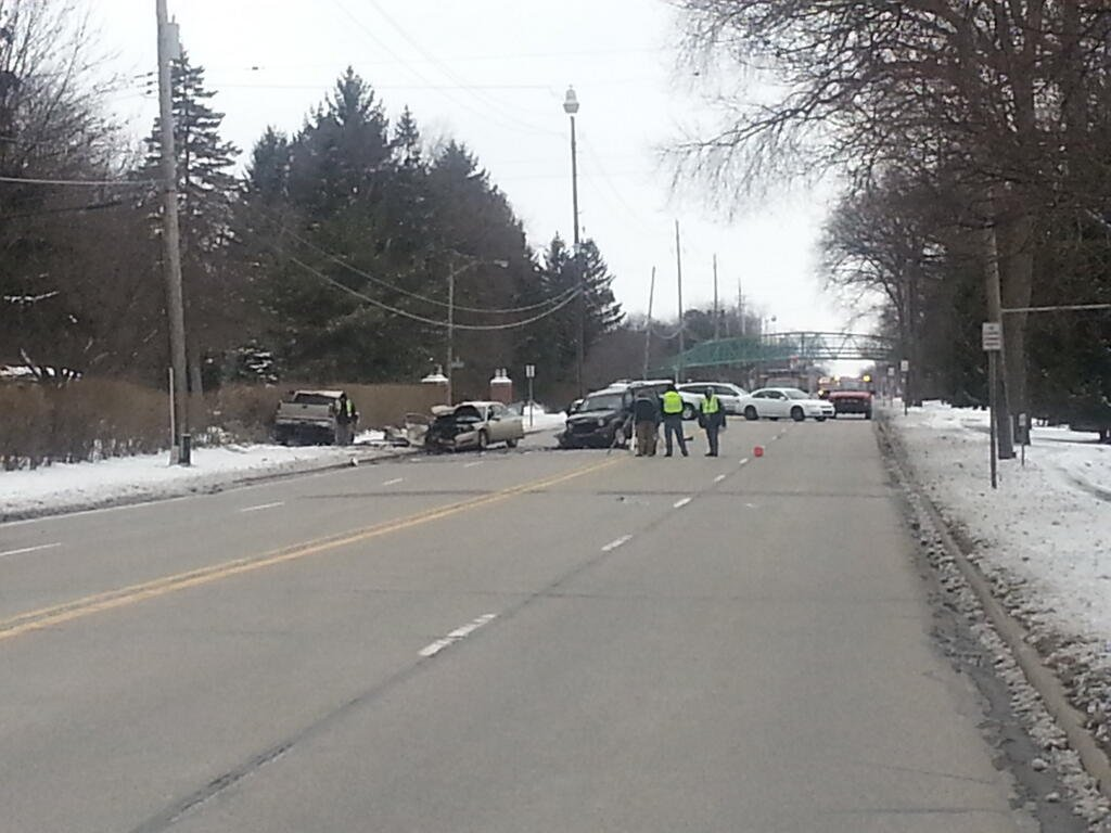 An accident investigation team examines the scene on Wednesday afternoon.