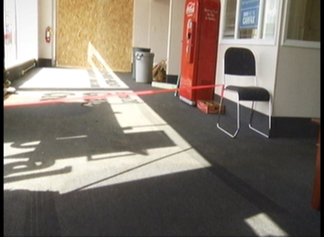 Tread marks are visible in this photo showing the inside of the showroom.