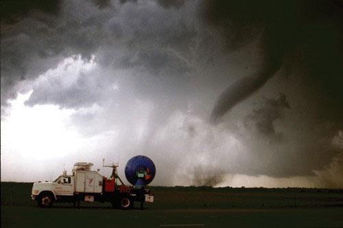 A Doppler radar truck tracking a tornado.
