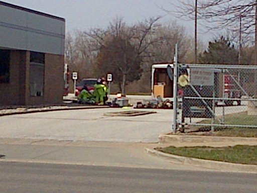 The HAZMAT team with their trailer outside the senator's office.