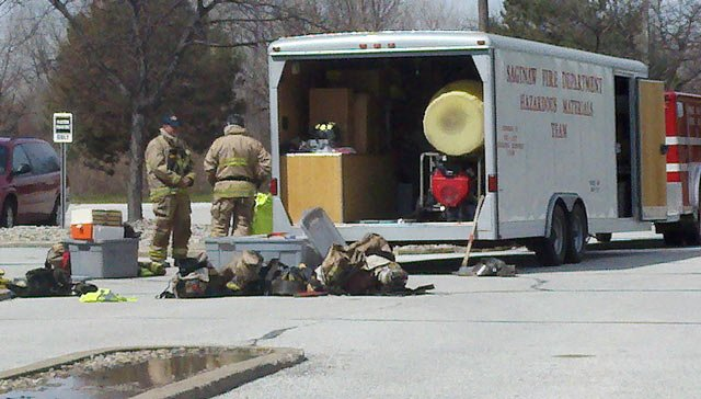 A close up view of HAZMAT crews at the scene.