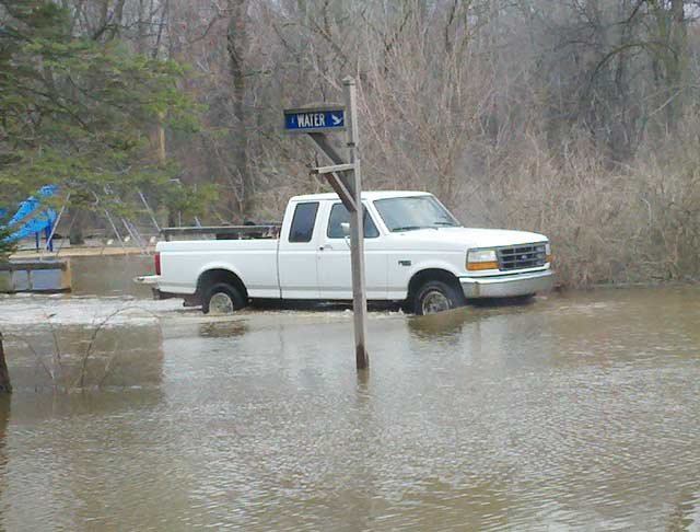 A pick-up sitting in high water.