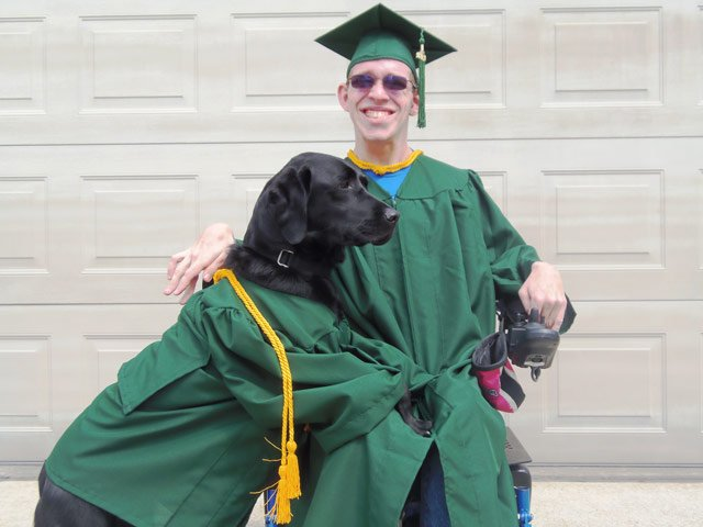 Alan Reno and his service dog, Roxie.