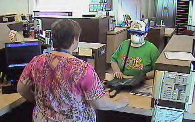 The suspect speaking with a bank employee.
