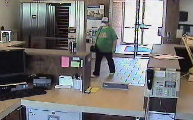 The suspect walking into the bank.