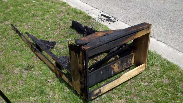 What's left of a couch that was set on fire by students last week.