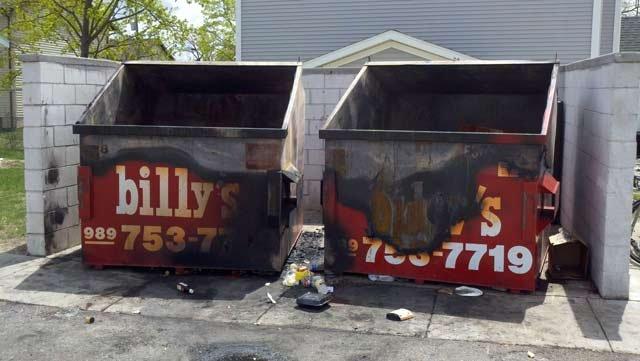 Two dumpsters that suffered burn damage last week.