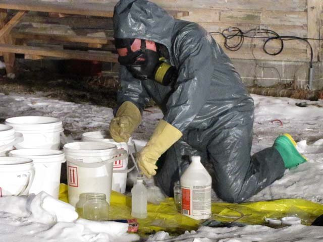 This photo shows an investigator cleanup up after a meth lab in Mid-Michigan earlier this year.