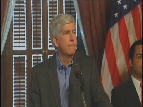 Gov. Rick Snyder taking questions from reporters in Lansing on Thursday.