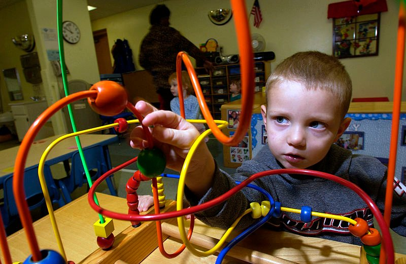 A child playing at a daycare center.