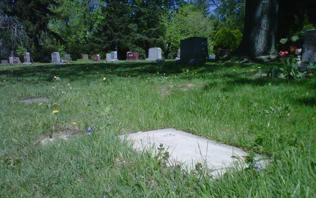 The spot where a grave marker was stolen from Gracelawn Cemetery.