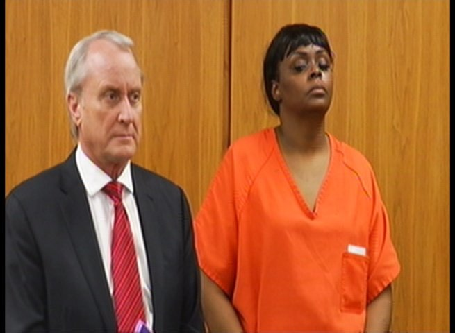 Sherina Parks standing next to her attorney in a courtroom on Thursday.