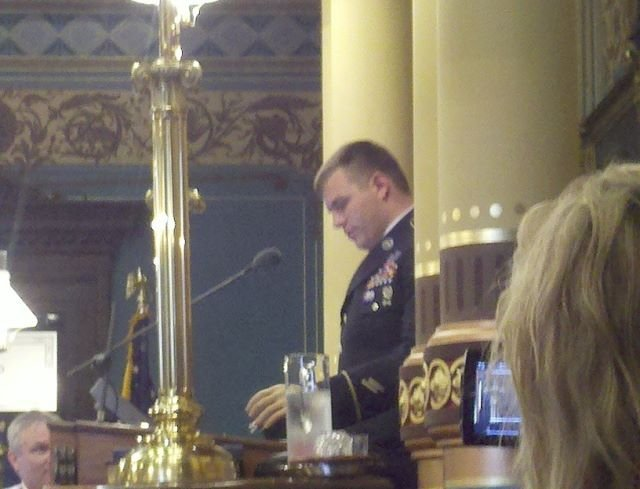 Army Sgt. Travis Mills addressing lawmakers in Lansing on Thursday.
