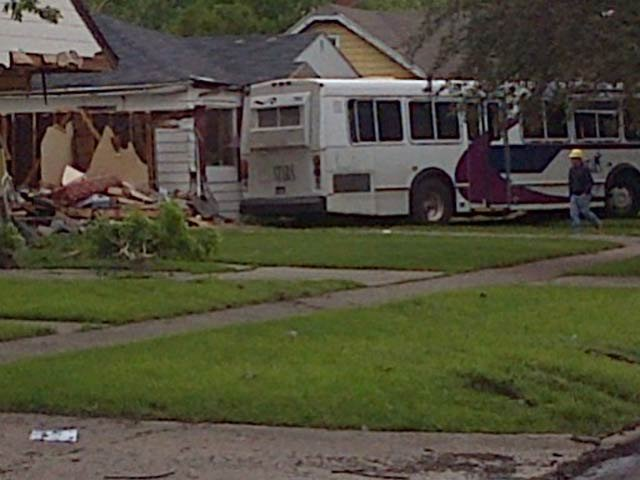 Damage left behind after the bus went off the road and into the homes.