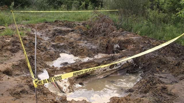 It doesn't look like much, but police say that's a buried boat on a property not far from Vassar.