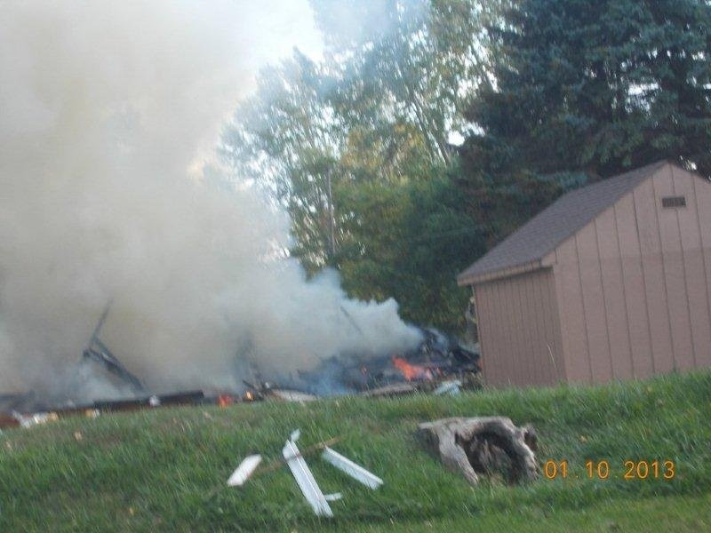 The smoking rubble of the exploded home