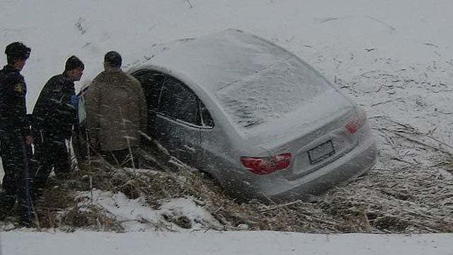 A car in a ditch.