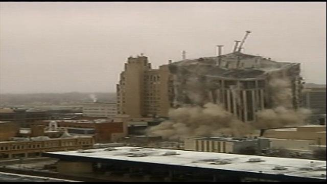 The building mid-collapse on Sunday morning.