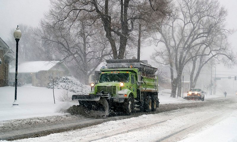 A plow truck working to clear roads.