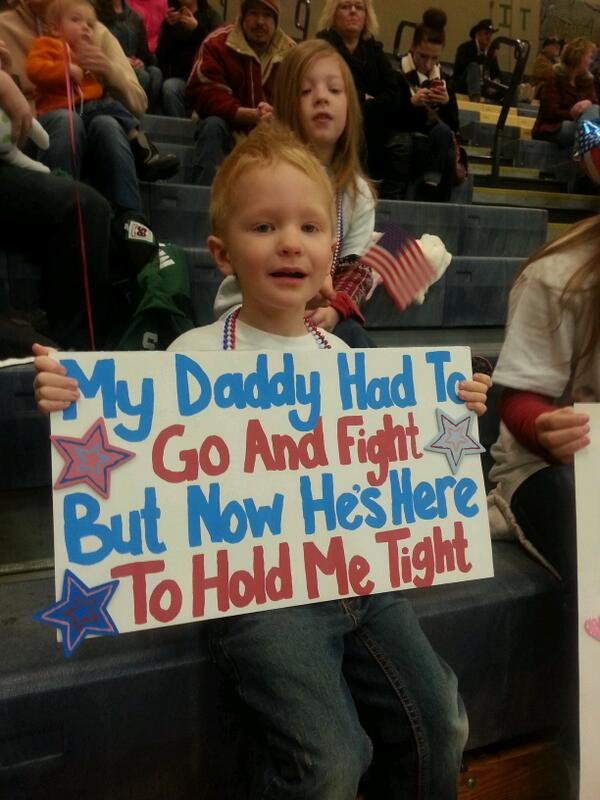 This boy was waiting in the crowd for his dad to arrive on Thursday.