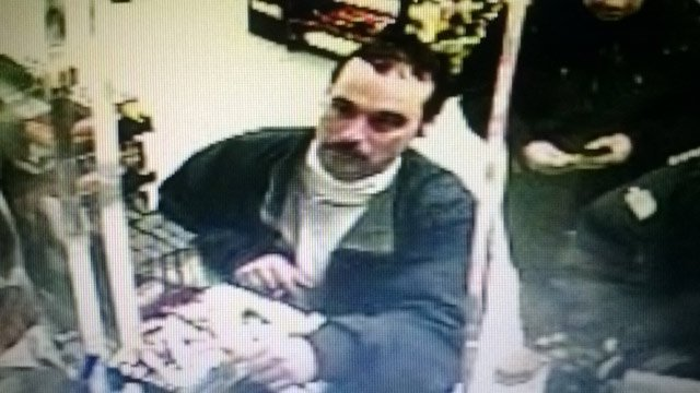 Michael David Elliot captured on surveillance camera at a convenience store in Indiana.