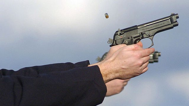 A file photo of a person firing a handgun.