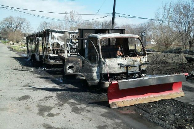 Detroit police find trucks charred in Detroit.