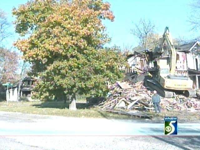 A blighted home being demolished.
